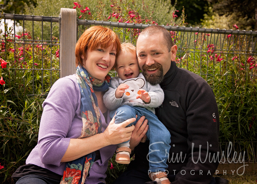 parents-holding-baby-having-fun-on-photography-shoot